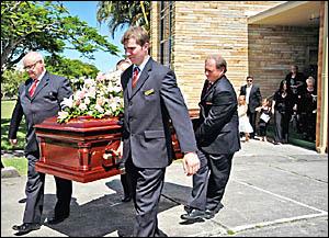 Pallbearers leave St Francis Xavier Catholic Church in Ballina yesterday.