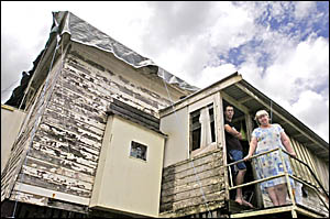 WAITING GAME: Judy Young and her son Mark, 16, pictured at their Lismore home that was damaged in the hailstorm in October. Pic