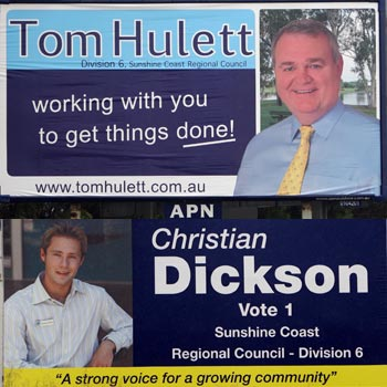 Must be an election coming... giant billboard signs for Tom Hulett and Christian Dickson - on the Sunshine Motorway near Sippy Downs.