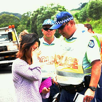 Scene of the accident on the Bruce Highway near Federal. A driver in the south bound lane ran off the road and down an embankment. Police talk to the distraught driver. Photo Warren Lynam