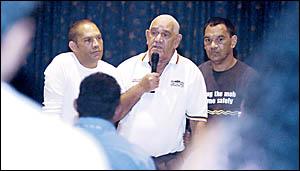 Bundjalung elder Lindsay Gordon (centre) addresses yesterdays protest meeting in Casino, flanked by his sons Lindsay Jnr (left