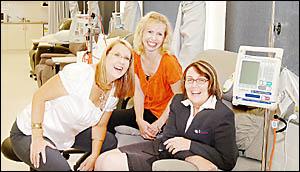 Clinical nurse consultant Sara Hurren (left) and patient administrator Allison Goodwin (centre) help Michelle McPherson, of Lis