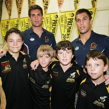 Broncos contracted brothers, Jason, left, and Joel Moon, at the Caloundra Sharks junior rugby league sign-on day with junior players (L-R) Tom Ackerman, James Barker, Shaun Smith and Aiden Smith. Photo: Brett Wortman/bw172665a