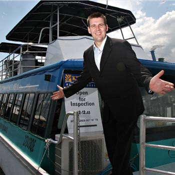 Real estate agent Anthony Gorman is taking potential property buyers on a canal buyers cruise. Photo: Robyne Cuerel/  172683c
