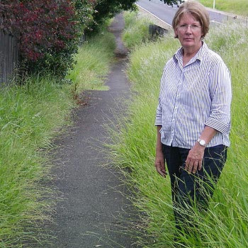 Division 9 candidate Vivien Griffin inspects an overgrown footpath in Bli Bli.
