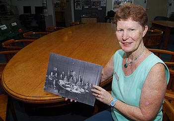 Caroline Foxon, Heritage Librarian for Maroochy Libraries, shows off the early council in the old council chambers. Photo: Che Chapman/CC172752