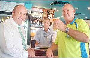 INSTANT RICHES: Ballina man Ken Mattinson (right), who won more than $1.8!million on Keno, toasts his good fortune yesterday as