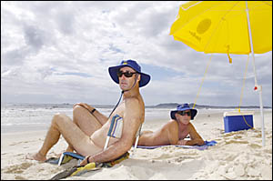 Enjoying a day at Tyagarah Beach are nudists Col Peake, of Woodburn, and Lismores Peter Bartusch, members of the nudist associ