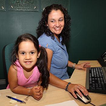 Carol Castillo and five-year-old Madisun at Mooloolaba law firm Munro Thompson. Photo: Nicholas Falconer/170489