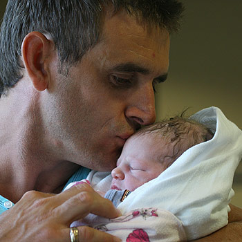 Richard Chapple would love to have two weeks paid paternity leave to spend with new daughter Riley Shae. Photo: Robyne Cuerel/172856j