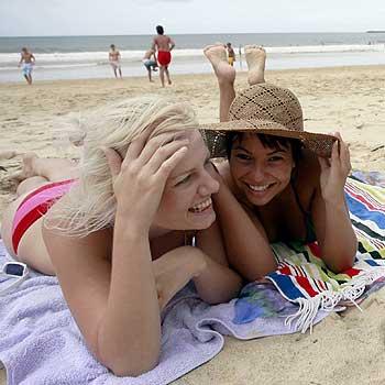Kahlee O'Sullivan and Ivana Ferreira tried to get some sunshine while on the Sunshine Coast, but the rain kept interfering. Photo: Kari Bourne/KB172842a
