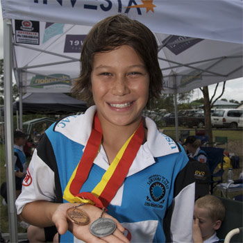 Joel Miles shows  off his silver and bronze medals that he won at  the regional zone competition at Gympie last weekend.