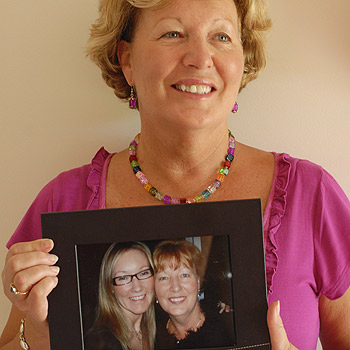 Pam Mapes holds a photo of herself and daughter Narissa, who has started a charity to raise awareness of Parkinson's disease. Photo: Warren Lynam/172301