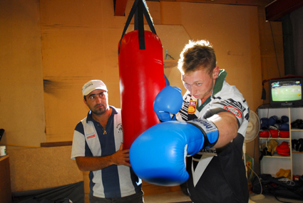 Mick Magnay (left) takes Bellingen forward Matt Bush through his boxing paces ahead of tomorrows fight night.