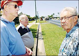 ROAD WOES: Local residents Ken Hope (left), Keith Rigby and Jim Cross look on in disgust at the roadwork in Bentinck Street, Ba