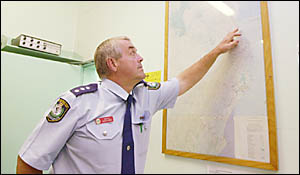 FRANTIC SEARCH: Inspector Owen King, of Byron Bay police, illustrating to the media the%area where the trawler is believed to h
