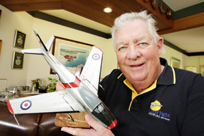 John Chesterfield with a model of a Sabre jet.