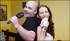 KARAOKE COUPLE: Karaoke final hopefuls are Goonellabah couple Jeff Morris and Naomi%Watson, pictured getting in some practice a