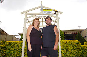 Gail and John Stevens, pictured outside their Goonellabah home, had three home-made bombs thrown at their house.