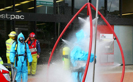 Emergency ... Seven people were decontaminated after white powder was discovered.