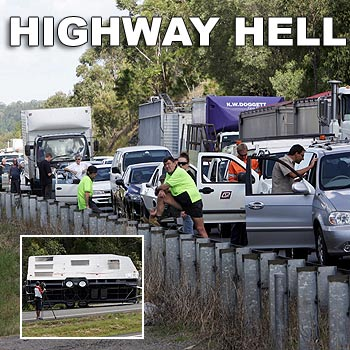Traffic backed up for several kilometres as motorists waited for emergency services to clear the scene of a caravan rollover on the Bruce Highway just south of the Caloundra turn-off. Photo: Chris McCormack/ 174471e