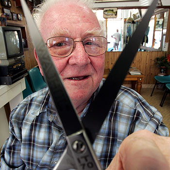 Keith Lipke has been a barber in Nambour for 52 years and used to cut Kevin Rudd's hair. Photo: Chris McCormack/174472