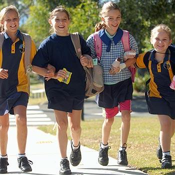 Chloe Bounty, Simone Ballard, Ashleigh Jones and Matilda Smith walk to class at Our Lady of the Rosary School. Photo: Warren Lynam/ 174455