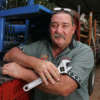 Woombye crane-truck operator Lindsay Robinson reckons he's a pretty typical Aussie bloke ... even if he does don a pink shirt now and again. Photo: Brett Wortman/bw174514e