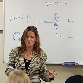 Life coach Brigitte Hinneberg presents a seminar outlining ways to achieve a better work/life balance for employees of the Budget Direct call centre at Kawana. Photo: Brett Wortman/174276