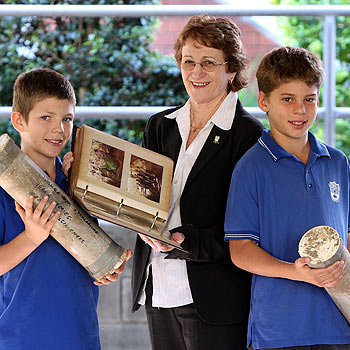 Former Mooloolaba State School P and C president Alison Quirke with Year 7 student leaders Tom Buckle and David Selvage with the time capsule Ms Quirke put in the ground in 1983.