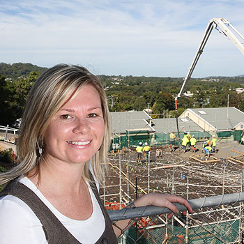 Reed Charity Foundation's Kellie Thomson witnesses the first concrete slab being laid at the foundation's accommodation project beside the Nambour General Hospital. Photo: Michaela O'Neill/174618