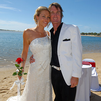 Former Australian Lifesaving captain Steven Short and Beverly Grant marry at Cotton Tree on the Maroochy River. Photo: Warren Lynam/174587