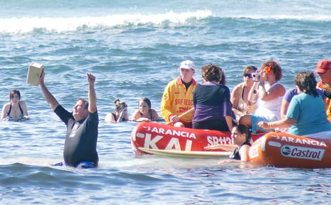 Neil Edmonds, father of Peter, raises both arms skywards after scattering his sons ashes in the ocean off Lennox Head.  Peter, 16, of Wollongbar, died after being attacked at North Wall, Ballina, on April 8.