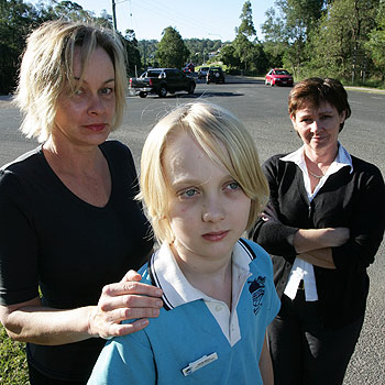 Parent Dianne Bull with her son Jack, 11, and Matthew Flinders Parents and Friends vice president Jan Vautin are concerned about the safety of pedestrians trying to cross Dixon Road. Photo: 174815
