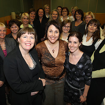 Michelle Hamer, front left, and Sharon Hogan, front centre, with the For Women By Women seminar participants. Photo: Michaela O'Neill/174606