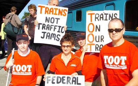 TOOT members staging a 'bring back our trains' protest at Casino rail station.