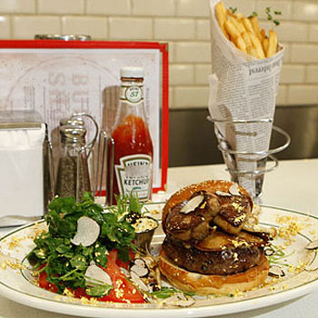 The Wall Street Burger Shoppe's $180 hamburger, featuring a bun flecked with gold leaf, a slab of foie gras and black truffles.