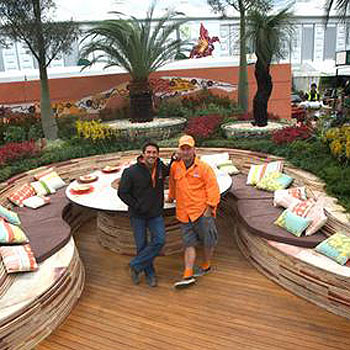 Jamie Durie and Wes Fleming stand in the middle of their Australian garden, which won a gold medal at the Chelsea Flower Show.