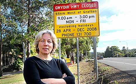 Elizabeth Deskoski and the RTA sign she wants removed.