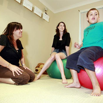 Liz Harberger and volunteer Alicia Wright are seeking help with the care of autistic children like Liz's son Josh, 7.