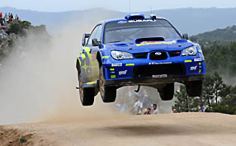 Norway's Peter Solberg with British co-pilot Philip Mills get their Subaru Imprezza WRC airborne during the Terranova special.