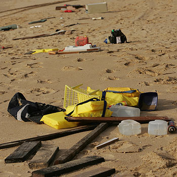 The remains of the luxury cruiser Islander are scattered along the beach at Buddina. The boat disintegrated after being beached on May 23. Photo: Jason Dougherty/174981