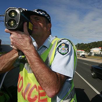 Traffic Senior Constable Glen Lewis has his eye on the traffic. Photo: Barry Leddicoat/174913f
