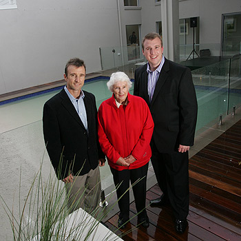 Adenbrook Homes directors Bill, right, and Robert Douglas officially open their new display home at Pelican Waters with the help Judy Henzell. Photo: Brett Wortman/175056