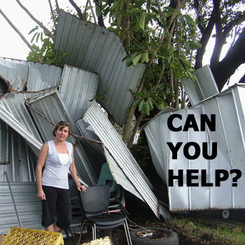 Bev Ward surveys the damage to the Breakers' equipment sheds caused by Sunday's storms. Photo: Mike Garry/scw810c