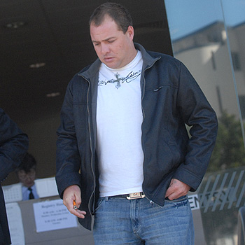 Mark Sullivan leaves Maroochydore Court after telling an inquest into the April 2006 disappearance of Ross Irwin from a fishing trawler that he believed Mr Irwin may have suffered a heart attack before falling overboard. Photo: Warren Lynam/175201