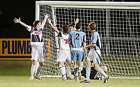 Rovers players Adam Gray (left), and Ben Casagrande celebrate after scoring a goal.