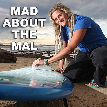 "Leanne ""Bluey"" Gilkes, the 33-year-old Alexandra Headland Malibu Club president, waxes her board as she prepares for the club's big event. Photo: Nicholas Falconer/175239"