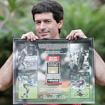 Mark Surplice of Bli Bli has a State of Origin 25th anniversary poster which is signed by Darren Lockyer, Arthur Beetson and Tommy Raudonikis. He is missing the signature of Danny Buderus, but he's hoping to get his autograph this week. Photo: Chris McCormack/175292