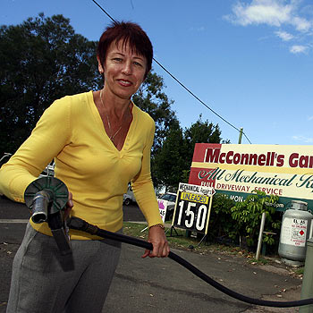 Carol Sherley fills up at her service station, which will close its doors at the end of the year. Photo: Barry Leddicoat/175312